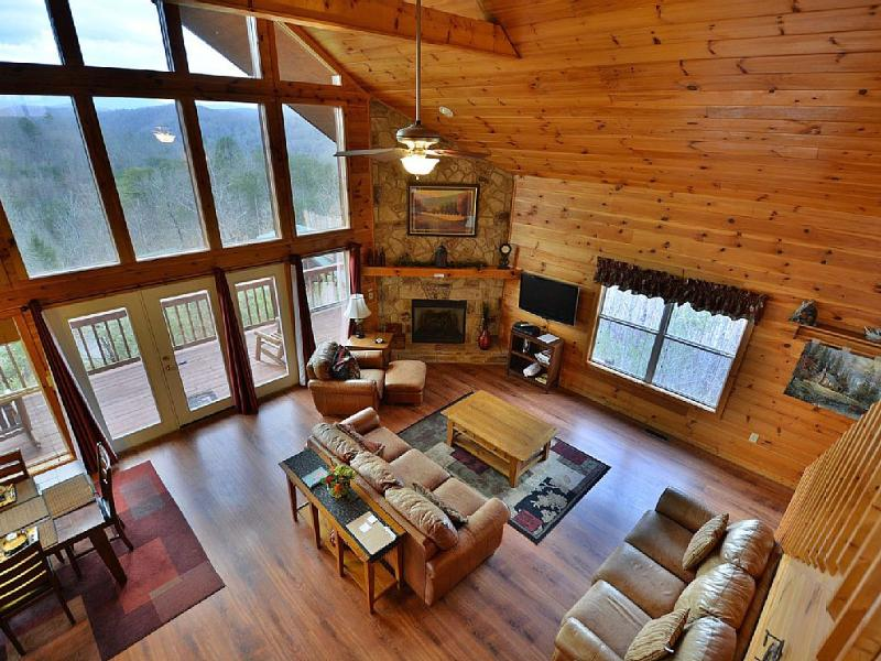 View from our loft/game room into our living room with floor to ceiling windows - BUCKHORN RETREAT Breathtaking Mt. Leconte Views - Sevierville - rentals