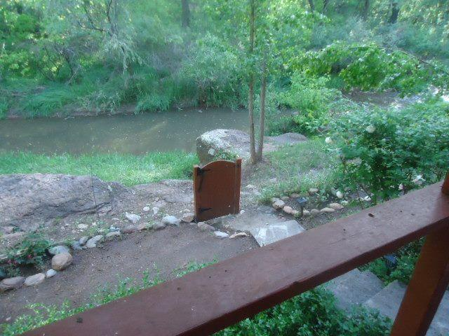 Back deck view of trout fishing hole, fishing poles and bait provided. - Cabin in Tall Pines on Tonto Creek - Star Valley - rentals