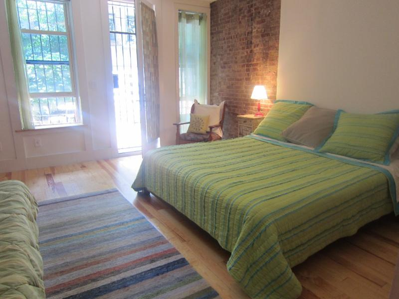 Bedroom with secure door onto patio - Charming and Spacious Garden Apt. - Manhattan - rentals