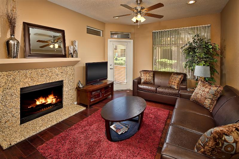 Cozy living room with queen sleeper sofa, HD TV, DVD Player, and candle lite fireplace! - Last Minute Deals! Heated Pool, Hot Tub, Best Area - Scottsdale - rentals