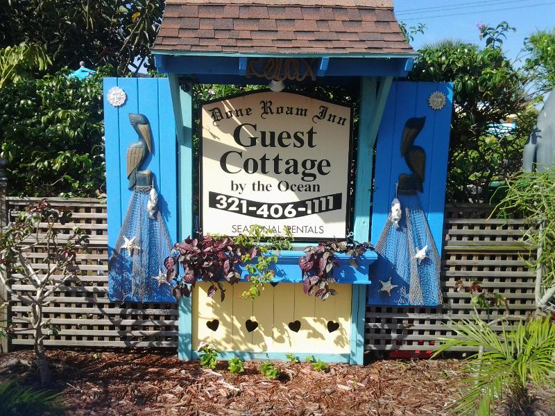 The updated Cottage sign, the first thing you'll see when you approach the Cottage. - The Guest Cottage, Manatee suite private and cozy. - Cocoa Beach - rentals
