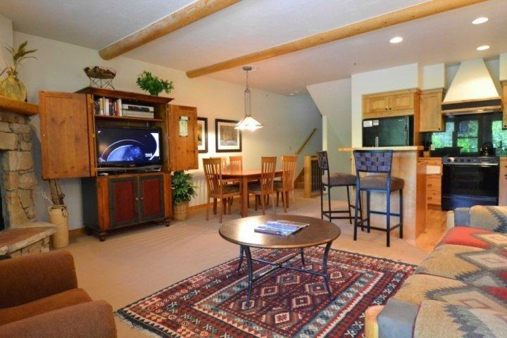 Living area with stone fireplace and mantle, HDTV (cable, DVD) and plush furnishings. - Deer Valley Foxglove - Park City - rentals
