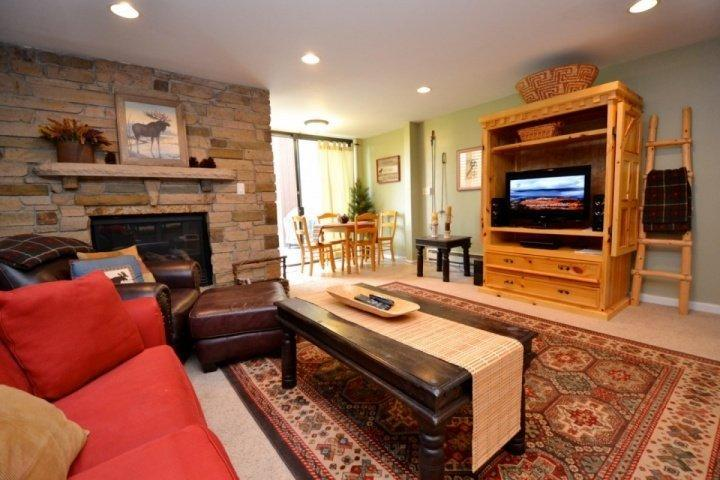 Living area with natural stone fireplace, HDTV, dining for four (4) and access to the backyard deck / patio. - Three Kings Two Bedroom Eagle - Park City - rentals