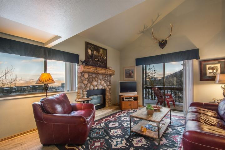Welcome to Red Pine Winter Way! It features a spacious great room with a river rock decor fireplace, flatscreen TV and comfortable new furnishings. - Red Pine Winter Way - Park City - rentals