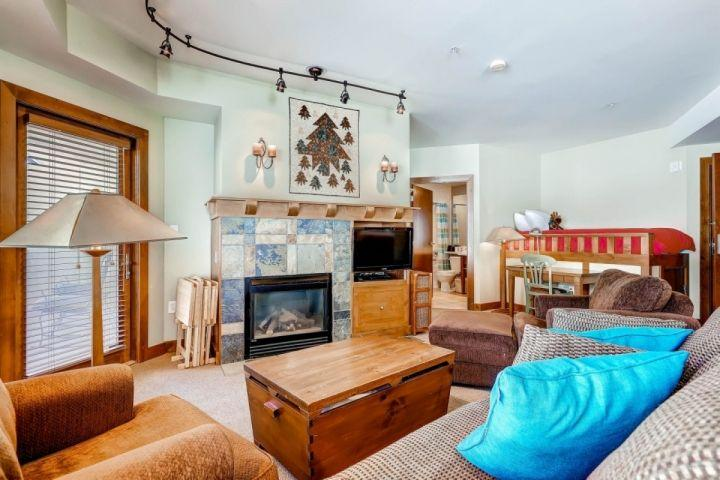 Living room / family room with comfortable furnishings, gas fireplace, flatscreen TV, pull out queen size sofa bed and private balcony. - Sundial 2 Bedroom Slopeside Suite - Park City - rentals