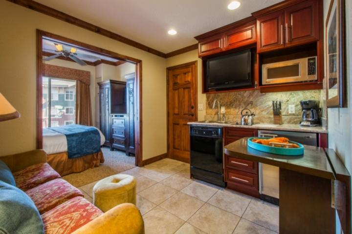 The gourmet kitchenette features a stainless steel mini-fridge, microwave, dishwasher, cherry wood cabinetry and stainless steel fixtures & finishes. - Westgate Studio Tranquility - Park City - rentals