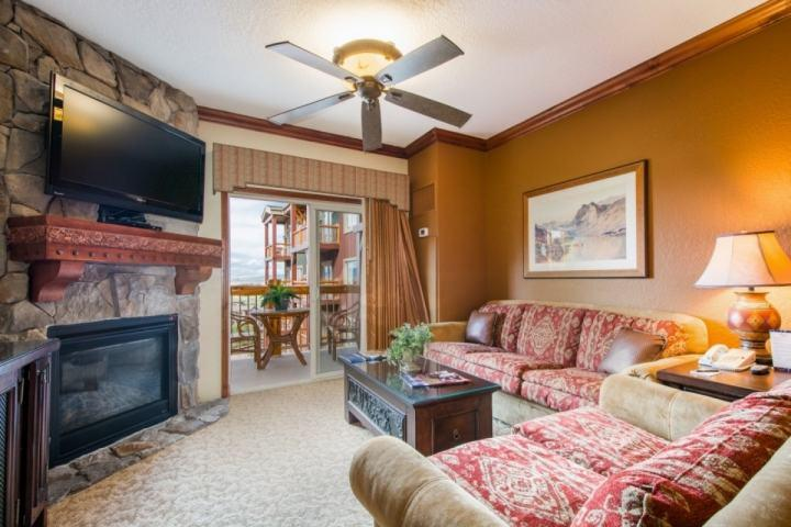 "The living room is equipped with a plush couch, love seat, 50"" HDTV, enhanced cable, DVD player, Wi-Fi and beautiful stone fireplace. - Westgate 2 Bedroom Tranquility - Park City - rentals"