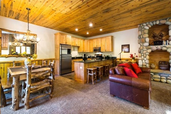 The room is tastefully decorated with warm cedar paneling, oversized windows and a floor to ceiling river rock fireplace with timber finishes. - Timber Wolf Lodge at Canyons 8A - Park City - rentals