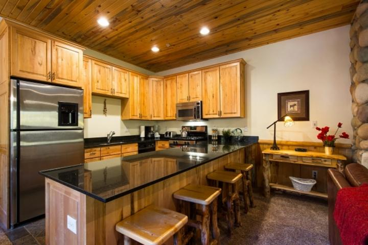 The gourmet kitchen features hardwood cabinetry, recessed lighting, granite counters & an array of stainless steel appliances - gas stove, fridge. - Timber Wolf Lodge at Canyons 8A - Park City - rentals