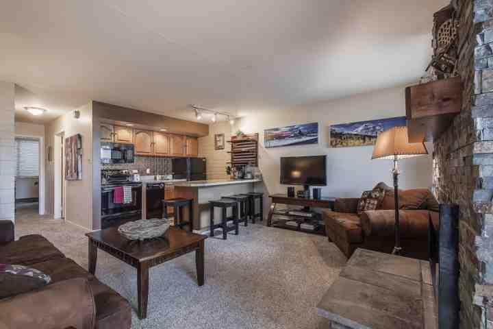 The living room offers beautiful new furniture, large HDTV with full entertainment center and floor to ceiling stone fireplace. - Park Avenue 1 Bedroom Condo - Park City - rentals