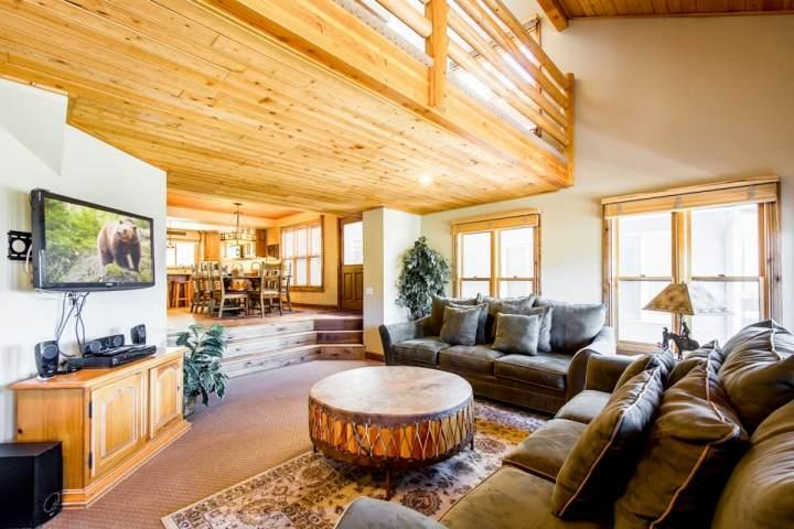 The living room is equipped two (2) plush couches that surround wood-burning fireplace with floor to ceiling stonework and the entertainment center. - Mountainside Park City Silver Hollow 1177 Lowell Avenue - Park City - rentals
