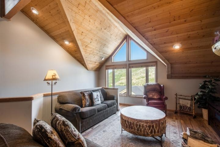 """The family room has comfortable furnishings, 42"""" HDTV with Comcast TV, DVD player and LG sound system, fireplace and mountain views. - Mountainside Park City Solitude 1184 Lowell Avenue - Park City - rentals"""