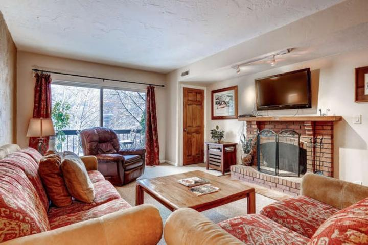 Spacious living room with comfortable seating for six (6), wood burning fireplace, private balcony and large HDTV. - Main Street Park Station - Park City - rentals