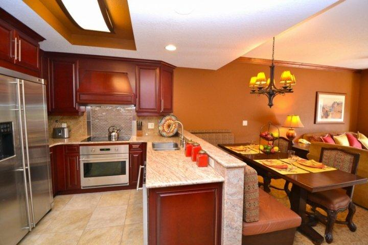 Gourmet kitchen features all stainless steel appliances including french door fridge, oven/stove, dishwasher, microwave and granite counters. - Westgate 1 Bedroom Suite Solace - Park City - rentals