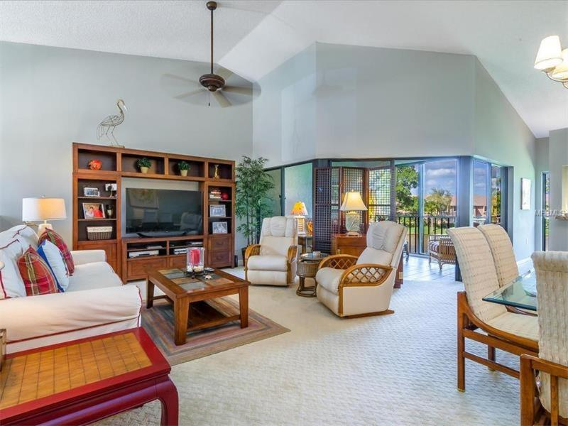 Open bright living room and dining room with vaulted ceilings - 3 BR/2 BA Upstairs Condo - Sarasota - rentals