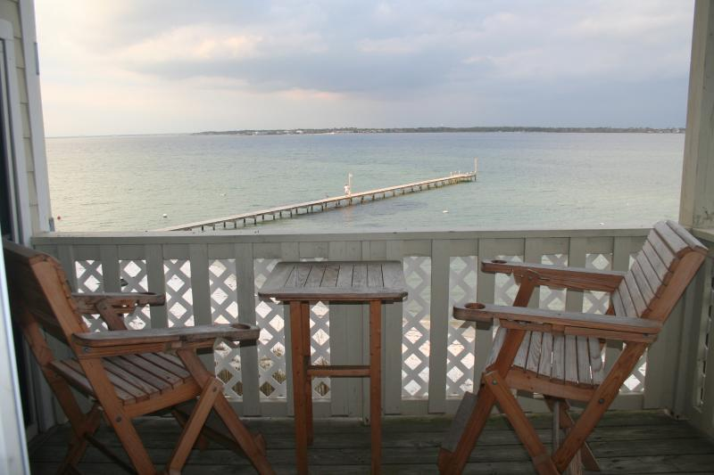 Enjoy a cocktail or dinner while relaxing on the balcony. - Available Memorial Day  - Remodeled Bathrooms and Great View - Pensacola Beach - rentals