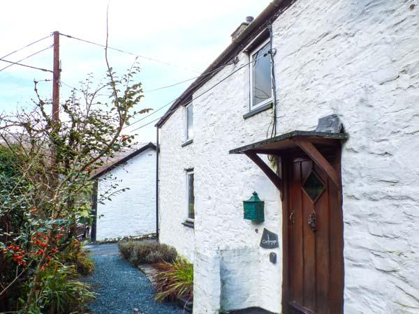 CHURCH COTTAGE, character, beams, inglenook fireplace with woodburning - Image 1 - Dinas Mawddwy - rentals