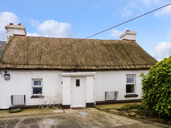 WHISPERING WILLOWS - THE THATCH, luxury thatched cottage, romantic retreat, multi-fuel stove, Malin Head, Ref 928919 - Image 1 - Malin Head - rentals