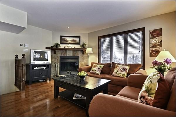 The Stunning Living Area has Beautiful Hardwood Floors and a Warm Wood Burning Fireplace - Cozy Wood Burning Fireplace - Summer Community Outdoor Pool (6013) - Mont Tremblant - rentals