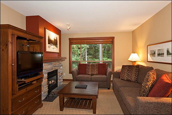 Elegant Living Room has a Flat Screen TV and Cozy Gas Fireplace - Forest View - Private Balcony (4023) - Whistler - rentals