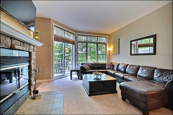 Beautiful Living Room Boasts a Cozy Fireplace and Cable TV - Lovely Views of the Forest and Mountain - Short Walk to Shuttle & Village (6025) - Mont Tremblant - rentals