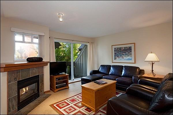 The Living Area Features a Gas Fireplace and Flat Screen TV - Private Outdoor Hot Tub - Underground Parking (4053) - Whistler - rentals