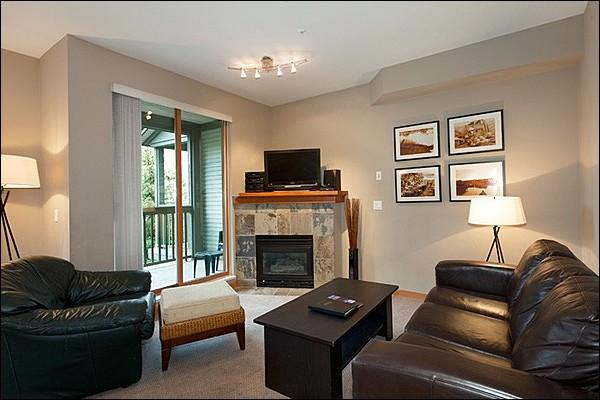 Spacious Living Room with Flat Screen TV and Gas Fireplace and Private Balcony Access - Just Steps from Marketplace Mall - Common Area Outdoor Pool & Hot Tub (4055) - Whistler - rentals