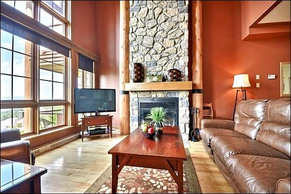 The Cozy Living Area with a Beautiful Stone Fireplace and Flat Screen TV - Incredible Mountain and Lake Views - Private Hot Tub  (6070) - Mont Tremblant - rentals