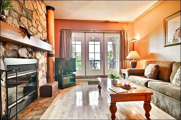 Enjoy the Large Flat Screen TV and Cozy Fireplace in the Living Room - Walk to Village Shops and Restaurants - Panoramic View of Lake Tremblant (6078) - Mont Tremblant - rentals