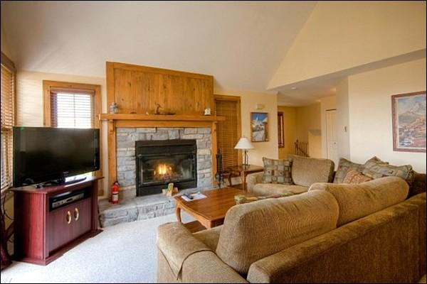 The Cozy Living Area Featuring a Stone Fireplace - Private Balcony with Patio Set and Summer BBQ - Perfect for a Multi Family Retreat (6107) - Mont Tremblant - rentals