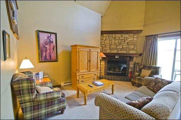 Living Room Features a Cozy Gas Fireplace and Cable TV - Beautiful Views of the Forest and Mountains - Unlimited Use of Practice Putting Green (6142) - Mont Tremblant - rentals