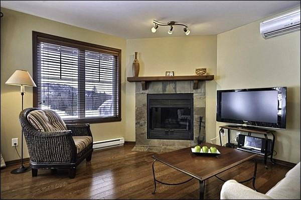 The Living Area is Welcoming and Features Beautiful Hardwood Floors - Common Area Pool Available in the Summer Months - Private Screened Terrace with Outdoor Patio Set and Summer Barbecue (6153) - Mont Tremblant - rentals