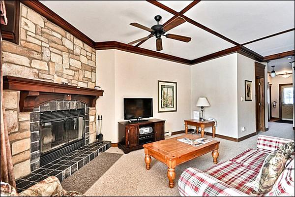 Stunning Living Area Offers a Stone Fireplace - Common Area Pool and Hot Tub Available in the Summer Months - Private Patio with Outdoor Patio Set and Barbecue (6151) - Mont Tremblant - rentals