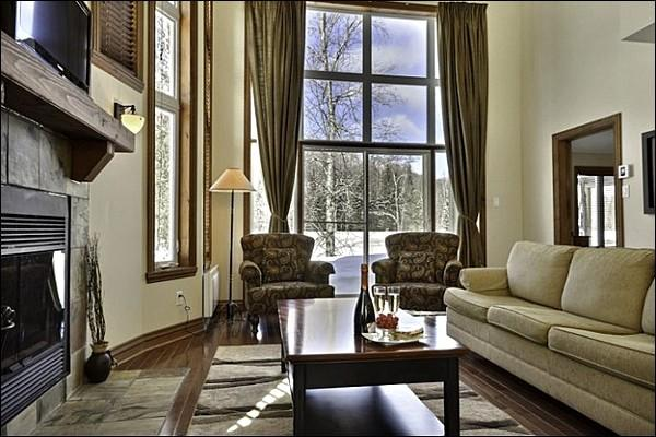 The Living Area is Cozy Offering you a Fireplace, and Welcoming Furnishings and Decor - Perfect for Golfers - Private Outdoor Patio with Beautiful Views (6160) - Mont Tremblant - rentals