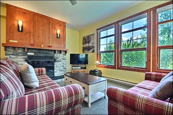 The Cozy Living Area Featuring a Stone Fireplace - Common Area All Year Hot Tub and Sauna - Perfect for a Romantic Get Away (6172) - Mont Tremblant - rentals