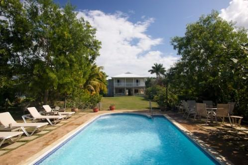 Coral Cove Villa shares a delightful waterfront on the clear waters of Discovery Bay - Image 1 - Discovery Bay - rentals