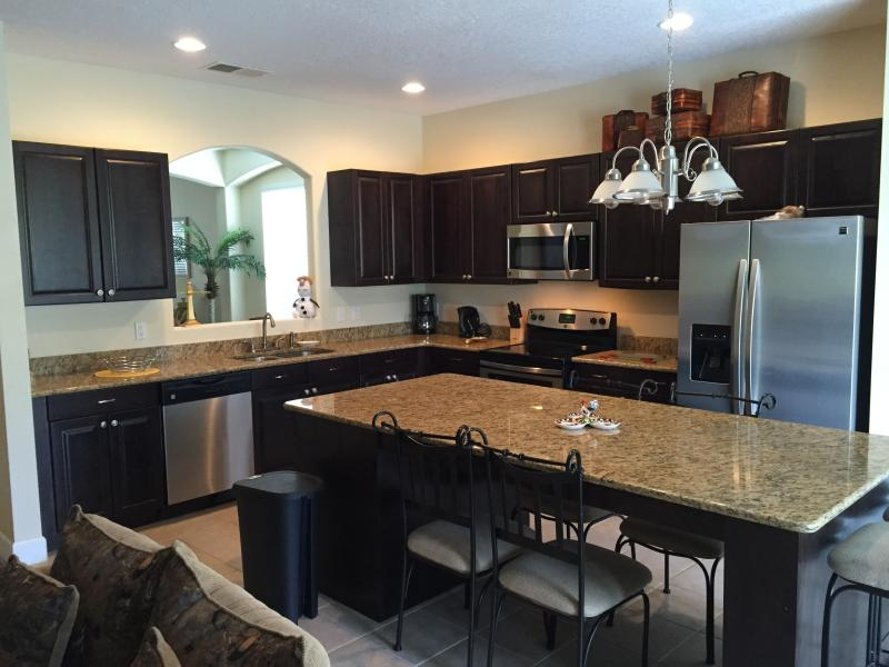 Granite countertop and stainless appliance make your cooking more enjoyable - Elegant, luxury & affordable 7 Bed 6 B @ Emerald - Kissimmee - rentals
