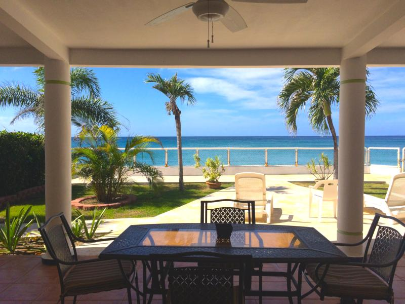Outdoor dining on the back patio with ocean and sunset views - Casa Bonita Beachfront Vacation Home - Rincon - rentals