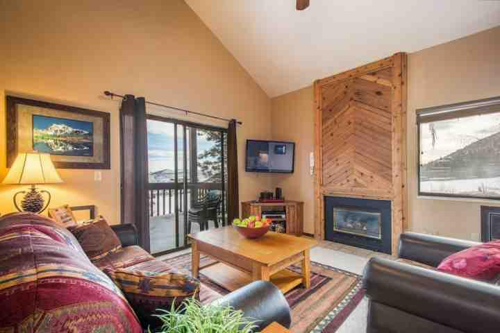"The living room features a large living area with plush leather furniture, gas fireplace, a 42"" HDTV and a sliding glass door to access your balcony. - Red Pine 2 Bedroom Sun Peak - Park City - rentals"