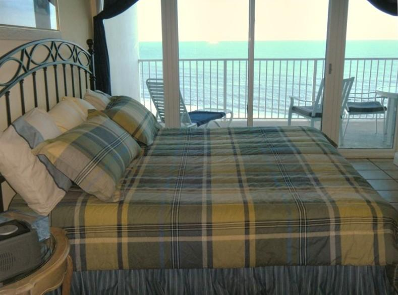 Master bedroom has king bed over looking Gulf Water with adjoining master bath. - Lighthouse Gulf Shores Front Door Parking - Gulf Shores - rentals