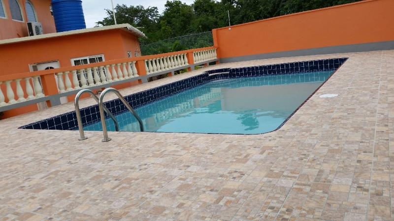 This wonderful secluded and refreshing pool is available for you right outside your room !!! - The Marabella - Falmouth - rentals