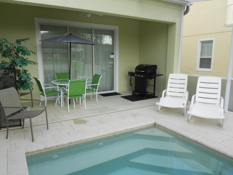 Back porch - heated private pool, gas grill - 3Bed/3Bath,Heated Splash Pool,Near Disney Orlando - Four Corners - rentals