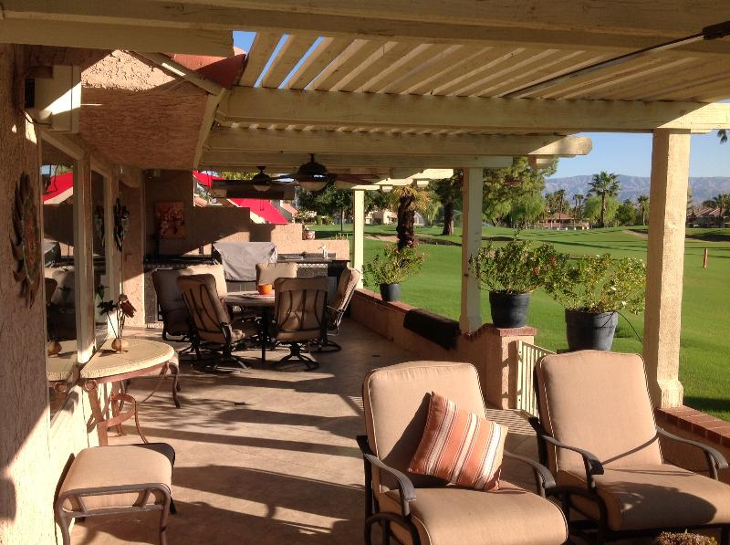 Large L-shaped Patio overlooking 4th fairway. - Vacation and Golf Paradise - Palm Desert - rentals