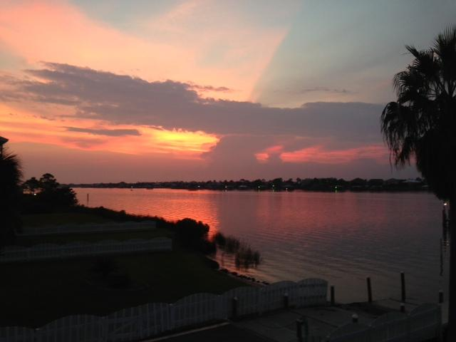 Enjoy gorgeous sunsets over scenic Old River from the breeze-filled screened back porch! - Lovely Waterfront Home, Pool Access, Boat Slip - Orange Beach - rentals