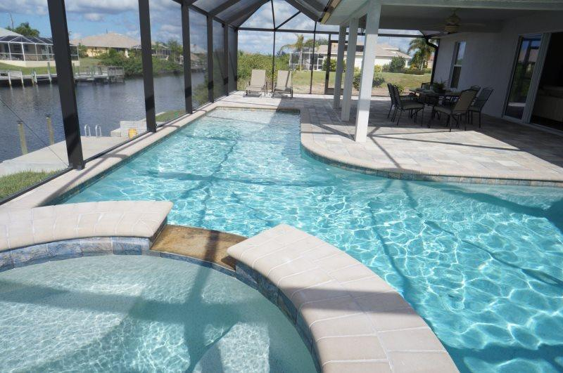 Marianne - Cape Coral 4br/2ba home w/electric and solar heated pool/spa, gulf access canal, HSW Internet, boat dock - Image 1 - Matlacha - rentals