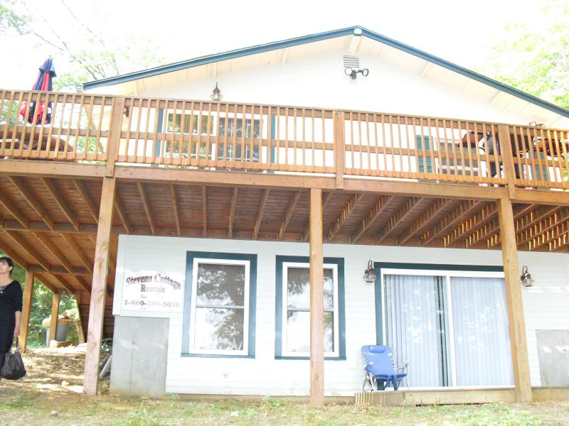 Large deck with grill and table for BBQ - Waterfront, dock 2 bedroom house on Sawyer Lake - Gilmanton - rentals