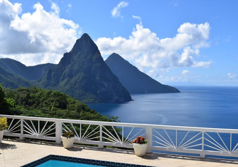 Another sunny day, enjoying our amazing view of both Pitons from the pool deck - Heavenly Views/Earthly Comforts.  Best Location - Soufriere - rentals
