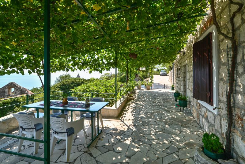 "Villa ANKA-entry, Outdoor terrace has a natural shade provided by grape vines,as well as sunny spots - Croatia Holliday Farmhouse in Dalmatia -  ""ANKA"" - Podaca - rentals"