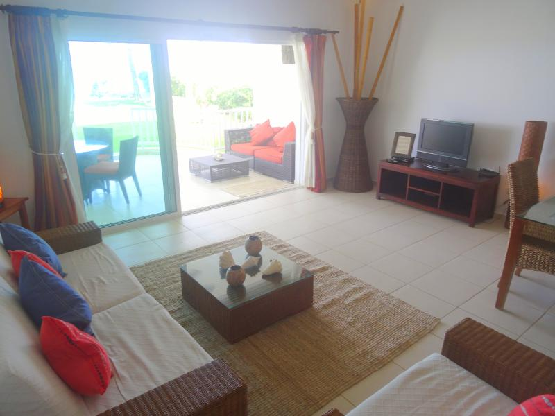 Living room with full sea view EVEN while sitting down. - Perfect Kiting condo ONLY 30 steps to beach - Cabarete - rentals