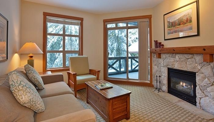 Relax in front of the fireplace in this cozy living area.  - Whistler Lost Lake Lodge 2 bed 2 bath - Whistler - rentals
